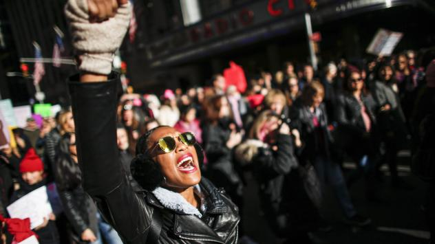 A woman shouts slogans during the Women's March in New York City, January 20, 2018, as protestors took to the streets en masse across the United States. It was a sign of lasting outrage, coming a year after the first women's marches following President T