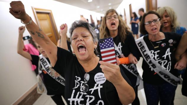 Dozens of protesters, including sexual assault survivor Mary Jane Maestras of Delta, Colo., demonstrate against the appointment of Supreme Court nominee Judge Brett Kavanaugh.