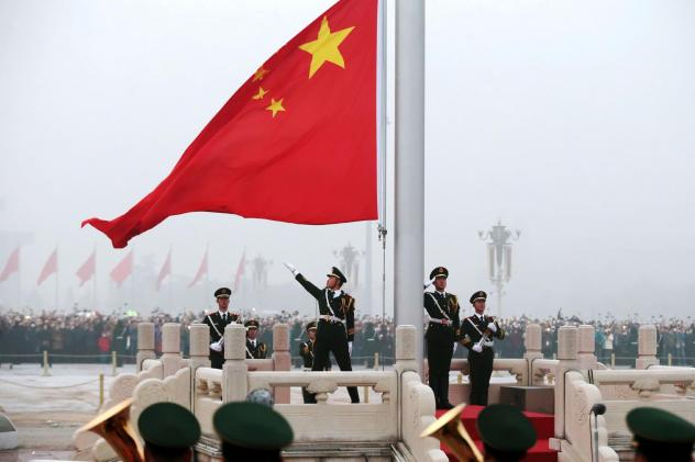 Honor guards attend a flag-raising ceremony at Tiananmen Square in 2017. Under President Xi Jinping, China has ambitiously pressed its advantage almost everywhere at once.