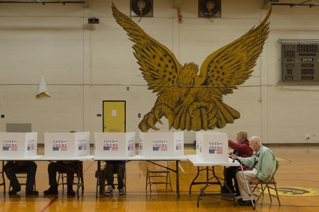 Voters cast their ballots at a polling station at Hazelwood Central High School on November 8, 2016 in Florissant, Missouri. A state judge has ruled state election authorities can no longer tell voters they must show a photo ID to cast a ballot, blocking