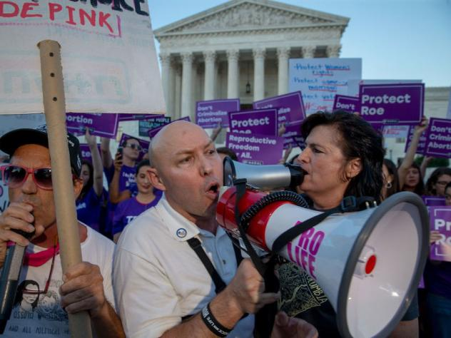 Protesters on both sides of the abortion debate demonstrated in front of the U.S. Supreme Court in July concerning Justice Brett Kavanaugh's confirmation. It is thought that a challenge to <em>Roe v. Wade</em> could have a chance of passing now that he i