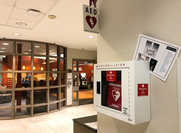 """Bridgewater State University campus police Detective Sergeant Robert McEvoy led the effort to place """"Opiod Overdose Kits,""""  containing the overdose reversal drug Narcan, to more than 70 locations on campus, including outdoor parking lots like this one."""