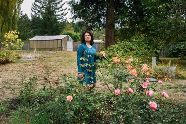 Janet Winston stands in her rose garden in Eureka, Calif. Testing revealed she is allergic to numerous substances, including linalool. Winston still can handle roses, which contain linalool, but she can't wear perfumes and cosmetic products that contain