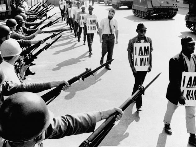 Civil rights activists are blocked by National Guardsmen brandishing bayonets while trying to stage a protest on Beale Street in Memphis, Tenn.