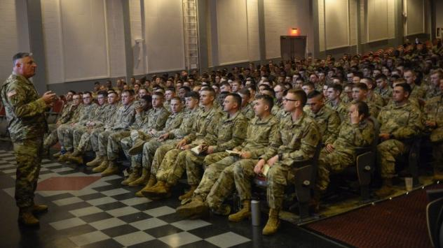 Members of the 89th Military Police and 541st Engineering Company, 19th Engineering Battalion at Fort Knox, Ky., are briefed upon arrival Wednesday at Lackland Air Force Base, Texas. They are among some 7,000 troops deploying to the U.S.-Mexican border.