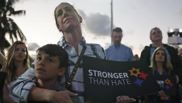 Taly Kogon and her son Leo, 10, listen to speakers during an interfaith vigil against anti-Semitism and hate at the Holocaust Memorial late last month in Miami Beach, Fla.