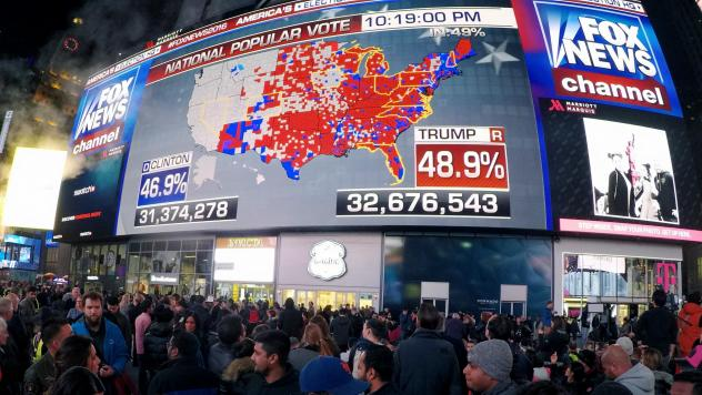 People watch election returns in Times Square on election night in 2016. After the exit polls appeared to be significantly off in that election, Fox News and the AP broke with other news organizations to start a new system. That could mean competing narr