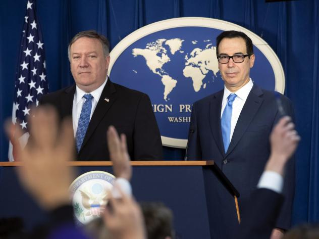 Secretary of State Mike Pompeo, left, and Treasury Secretary Steven Mnuchin present details of renewed U.S. sanctions on Iran at the Foreign Press Center in Washington, D.C., Monday.