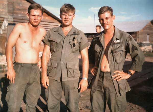 Staff Sgt. Tom Frame, the author's father, stands at right in this 1968 snapshot from Vietnam.