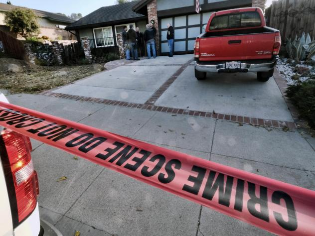 Ventura County sheriff's deputies stand outside the house of shooting suspect Ian David Long on Thursday in Newbury Park, Calif. Authorities said the Marine veteran opened fire at a country music bar in Thousand Oaks on Wednesday night.