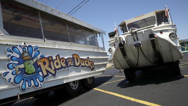 Duck boats sit idle in the parking lot of Ride the Ducks days after the accident in July in Branson, Mo. Kenneth Scott McKee, the captain and operator of a boat that sank on July 19, was charged on Thursday with criminal misconduct and negligence resulti