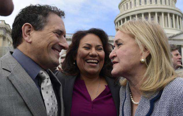 Rep.-elect Andy Levin, D-Mich. (left); Rep.-elect Veronica Escobar, D-Texas (center); and Rep.-elect Sylvia Garcia, D-Texas, talk following a photo of the incoming members of Congress on Capitol Hill on Wednesday.
