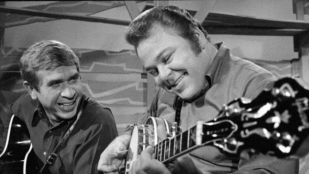 <em>Hee Haw</em> co-hosts Roy Clark (right) and Buck Owens in 1969. Clark died Thursday at the age of 85.
