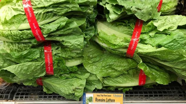 Romaine lettuce is displayed on a shelf at a supermarket in California in April, during an <em>E. coli</em> outbreak traced to contaminated lettuce. The CDC says a new outbreak has made lettuce dangerous to eat, just in time for America's most foodcentri