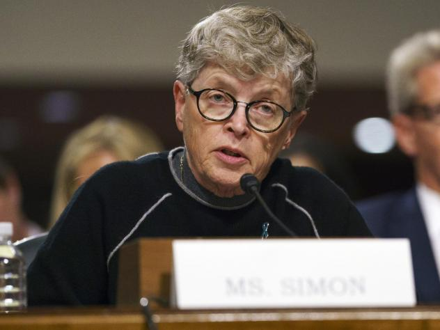 Former Michigan State President Lou Anna Simon, pictured before a Senate subcommittee in Washington, was charged on Tuesday with lying to police conducting an investigation of Larry Nassar's sexual abuse.