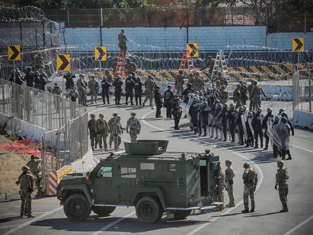 U.S. military and border agents secure the United States-Mexico border at the San Ysidro border crossing south of San Diego, Calif. on Nov. 25.