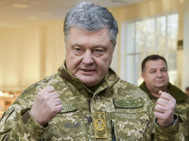 Ukrainian President Petro Poroshenko speaks to soldiers during a visit to a military base in Chernihiv region, Ukraine, on Wednesday. Russia and Ukraine traded blame after Russian border guards on Sunday opened fire on three Ukrainian navy vessels and ev
