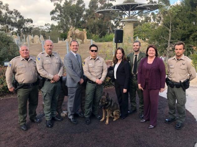 San Diego City Attorney Mara Elliott (middle) and California State Senator Toni Atkins (second, right) stand with officers from California's Department of Fish and Wildlife. The group announced charges in an ivory trafficking case Tuesday.