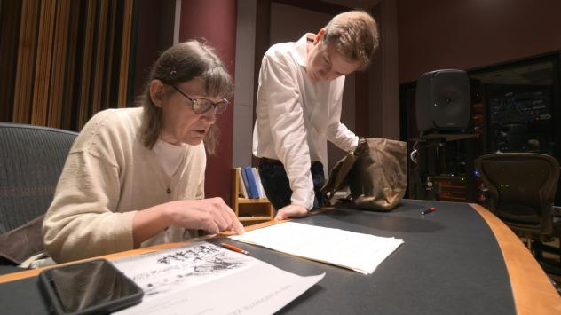 """Professor Patricia Hall and graduate student Joshua DeVries discuss the music manuscript for """"The Most Beautiful Time Of Life"""" at University of Michigan."""