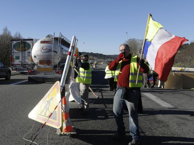 France Freezes Fuel Tax Hike In Face Of Yellow Vest Protests
