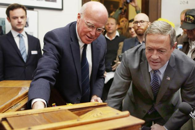 New Hampshire secretary of state Bill Gardner, left, shows former Maryland Gov. Martin O'Malley, the historic ballot box before O'Malley filed papers to run in the 2016 presidential primary. Gardner is the nation's longest-serving secretary of state and