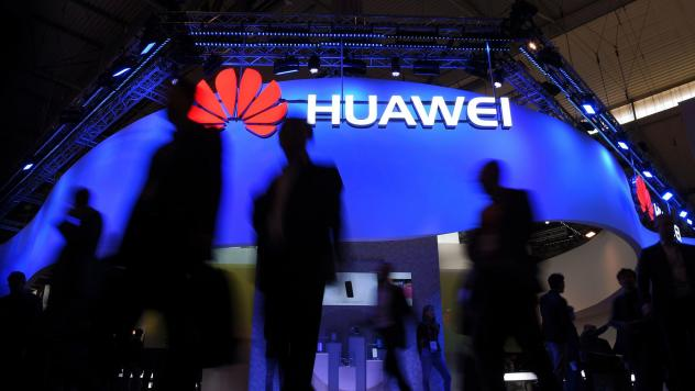 Visitors pass a Huawei marquee in Barcelona during the Mobile World Congress last year. The daughter of the Chinese telecommunications giant's founder was arrested Saturday in Canada on U.S. request, in a move that threatens to inflame U.S.-China trade t