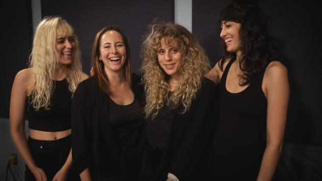 Doe Paoro (third from the left) with her band, inside the World Cafe Performance Studio.