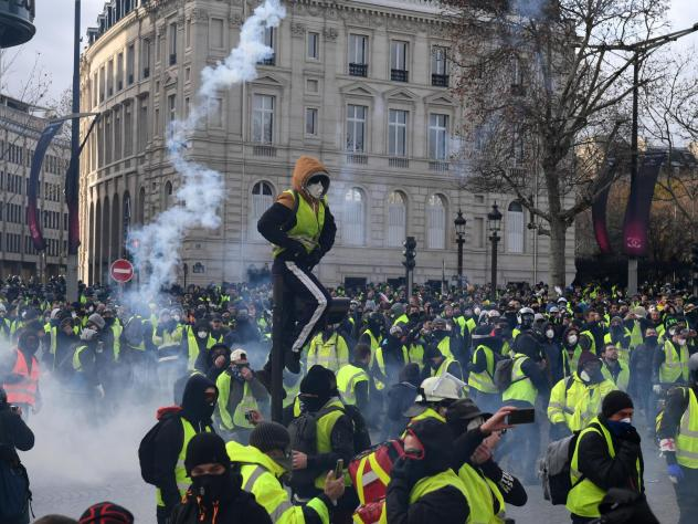 Tear gas was hurled as protesters, known as yellow vests, took part in a fourth demonstration in Paris on Saturday.