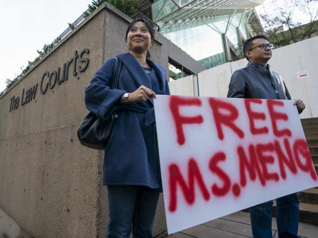 Supporters Ada Yu and Wade Meng (no relation) stand outside the British Columbia Supreme Court on Monday before the bail hearing for Huawei Technologies CFO Meng Wanzhou  in Vancouver.