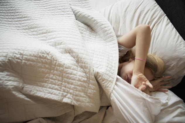 Teens' biological clock drives them to stay up late and sleep in. Most school start times don't accommodate that drive.