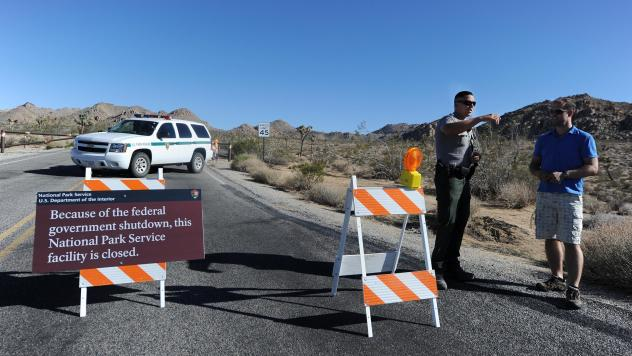 A U.S. park ranger gives a visitor suggestions of other nearby places he can visit while Joshua Tree National Park was shutdown in 2013.