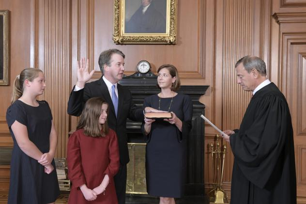 Chief Justice John Roberts administers the constitutional oath to Judge Brett M. Kavanaugh as his wife, Ashley Kavanaugh, holds the Bible. They're accompanied by their daughters, Margaret and Liza.