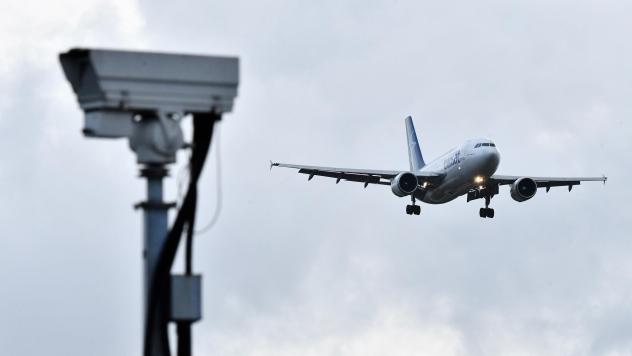 A jet lands at London Gatwick Airport on Friday. The airport had been closed for over a day after a drone repeatedly flew nearby.