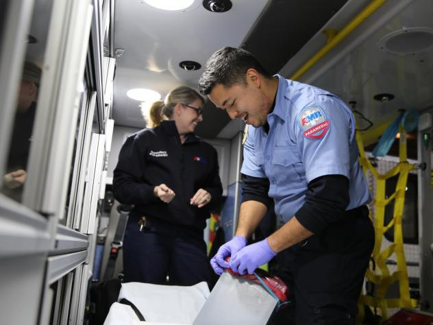 Talitha Saunders and AJ Ikamoto tidy their ambulance at the end of a recent shift. The two work as emergency medical responders in Oregon with American Medical Response in Portland. Leaders there are working to prevent any race-based disparities in treat