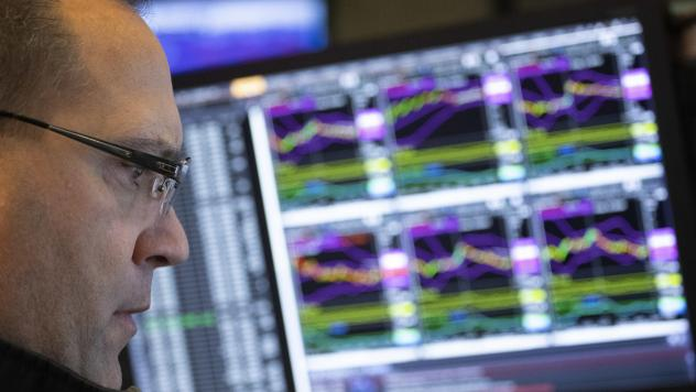 Anthony Matesic, a designated market maker, follows stock prices at the New York Stock Exchange, earlier this month.