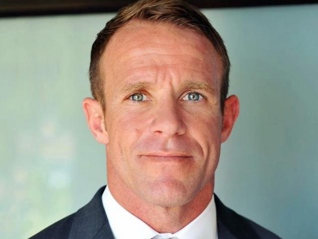 This 2018 photo provided by Andrea Gallagher shows her husband, Navy SEAL Edward Gallagher. Gallagher is facing charges of premeditated murder and other offenses in connection with the fatal stabbing of a teenage Islamic State prisoner under his care in