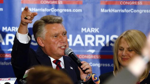 North Carolina 9th district Republican congressional candidate Mark Harris, with his wife Beth, claims victory in his congressional race in Monroe, N.C. The race, however, has yet to be certified as authorities look into fraud claims in the eastern part