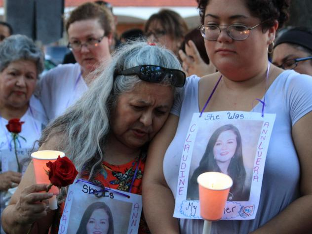 Family and friends of the four slain women gathered for a candlelight vigil at a park in downtown Laredo, Texas, in September. Juan David Ortiz has pleaded not guilty to charges of capital murder.