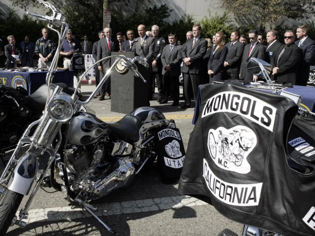 Law enforcement officials announce the arrests of dozens of Mongol motorcycle club members on murder and drug charges in six states in 2008.