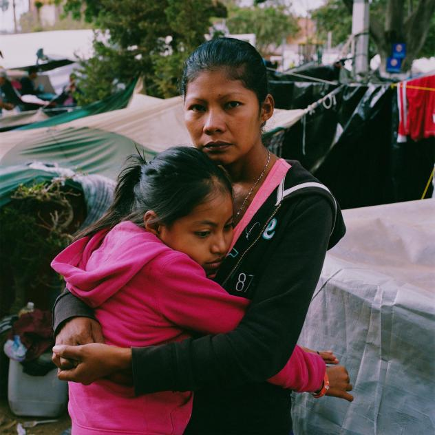 """Karen Paz hugs her daughter, Liliana Saray, 9. They are from San Pedro Sula, Honduras. """"I feel free; I feel different,"""" Paz said. """"I don't have someone who imposes his views and his ways on me. I am not scared someone will come and attack me, like I used"""