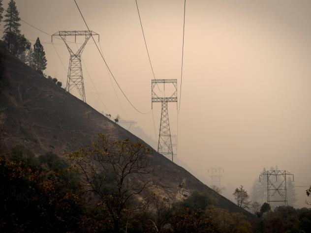 California utility PG&E Corp. said Monday that it plans to file for bankruptcy over what it estimates could be $30 billion in potential liability costs from recent wildfires. Here, transmission towers in a valley near Paradise, Calif., as the Camp Fire b