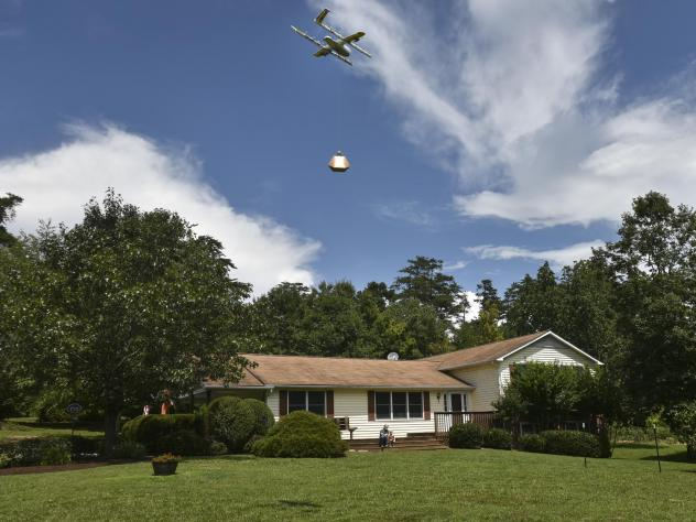Federal regulators have announced plans to allow drone operators to fly their unmanned aerial vehicles over populated areas and at night. A Wing Hummingbird drone from Project Wing arrives and sets down its package at a delivery location in Blacksburg, V