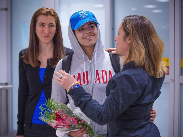 Rahaf Mohammed Alqunun (center) is welcomed by Canadian Minister for Foreign Affairs Chrystia Freeland as she arrives at Pearson International Airport in Toronto, Ontario, on Saturday. The young Saudi woman who fled her family successfully harnessed the