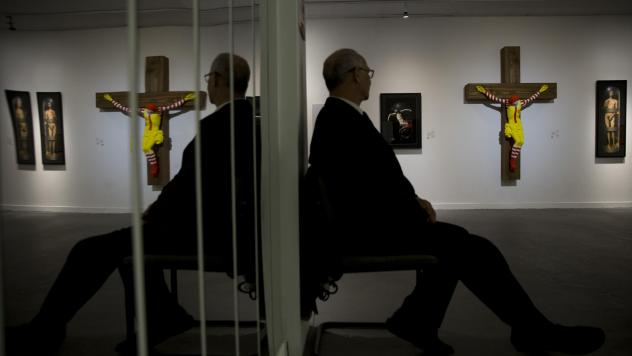 """The sculpture, known as <em>McJesus</em>, was created by Finnish artist Jani Leinonen and displayed as part of the Haifa Museum of Art's """"Sacred Goods"""" exhibition in Israel. The piece, seen on display in the museum Monday, prompted vehement pushback from"""