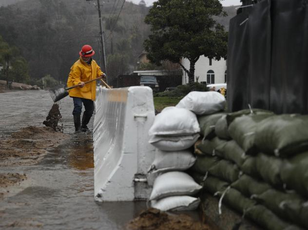 Lake Elsinore, Calif., on Thursday during a storm that dropped rain and snow across much of the state. The National Weather Service is providing forecasts and warnings as usual, but employees are working without pay.