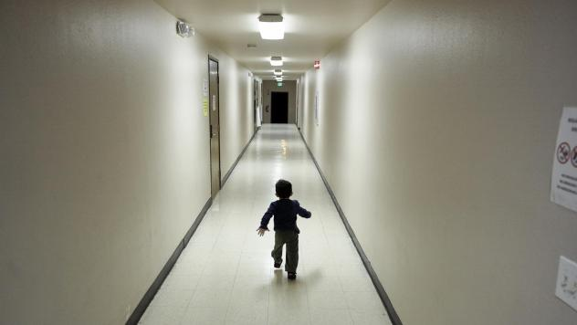 An asylum-seeking boy from Central America runs down a hallway in December after arriving at a shelter in San Diego. Immigrant advocates say they are suing the U.S. government for allegedly detaining immigrant children too long and improperly refusing to