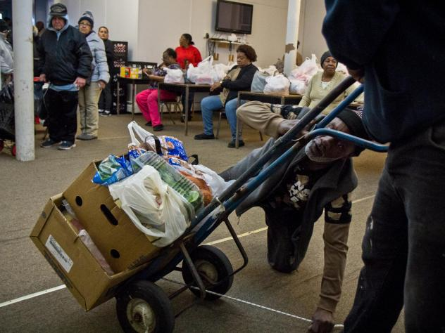 Volunteers at the St. James Chapel Church food bank in Reading, Pennsylvania, hand out food and help the older and disabled.