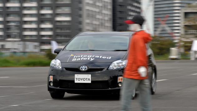 """Toyota demonstrates its """"pre-collision system,"""" which uses automatic steering in addition to automatic braking to prevent collisions, in Tokyo in 2013. Different manufacturers use different names for systems like this, which can be confusing, a AAA repor"""