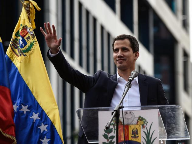 Venezuela's National Assembly head Juan Guaidó waves during a mass opposition rally, during which he declared himself the country's acting president on Jan. 23.