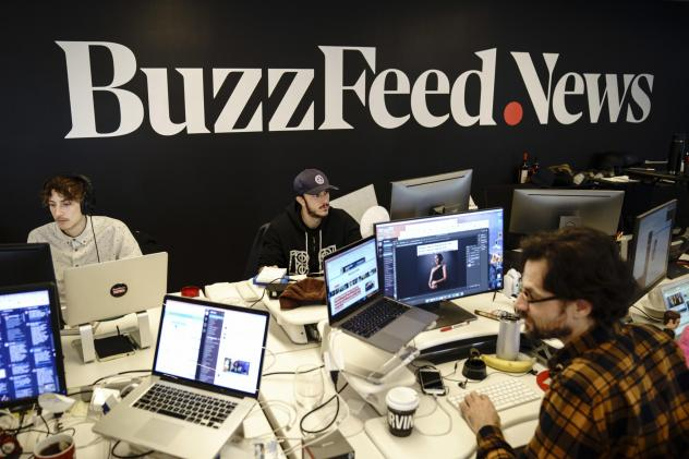 Members of the BuzzFeed News team work at their desks at BuzzFeed headquarters on Dec. 11, 2018.